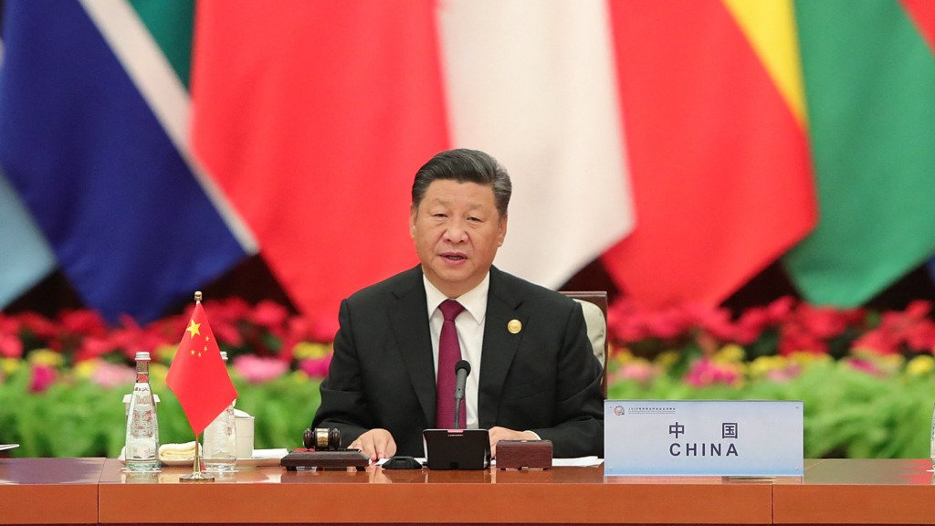 China's President Xi Jinping (C) speaks as South Africa's President Cyril Ramaphosa (L) and Equatorial Guinea's President Teodoro Obiang Nguema Mbasogo (R) look on.