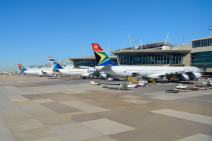 South African Airways and Egyptair aircraft parked at O R Tambo International Airport passengers terminal.