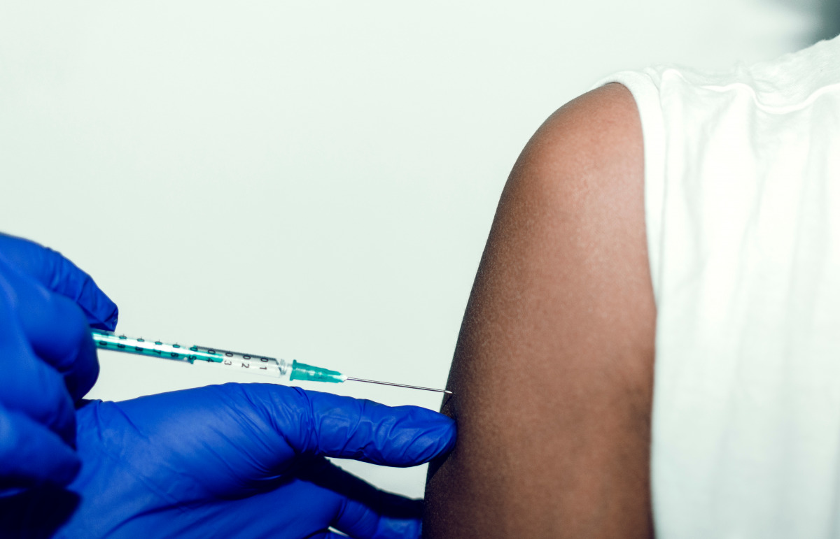 A patient receives a jab in the arm. Aspen will be the first company to produce Covid-19 vaccines in Africa.
