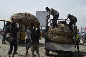 Nigerian workers load a truck. The government has launched a programme to employ unskilled workers in public projects.