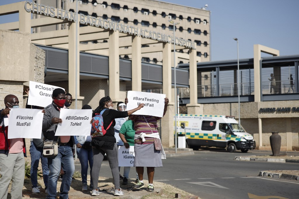 Demonstrators protest against the Covid-19 vaccine trial at the Chris Hani Baragwanath Hospital in Soweto.