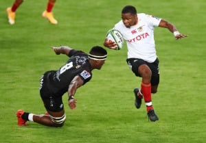 Phendulani Buthelezi of the Cell C Sharks tries to tackle wing Malcolm Jaer of the Free State Cheetahs during a Super Rugby Unlocked match in Durban.
