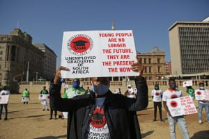 Unemployed South African graduates hold up placards as they protest in Pretoria.