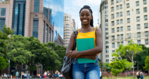 A female African student on the streets of an American city.