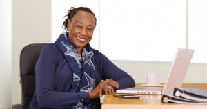 An African business woman at her desk.