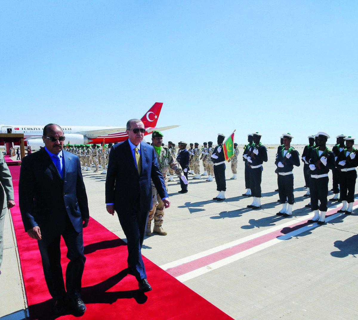 President Erdogan of Turkey walks on a red carpet upon arrival in Mauritania for a state visit.