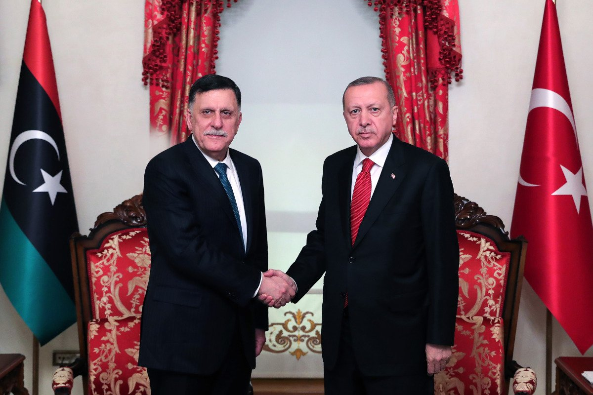 Turkish President Recep Tayyip Erdogan (right) shaking hands with Fayez al-Sarraj (left), the head of the Tripoli-based Government of National Accord (GNA).