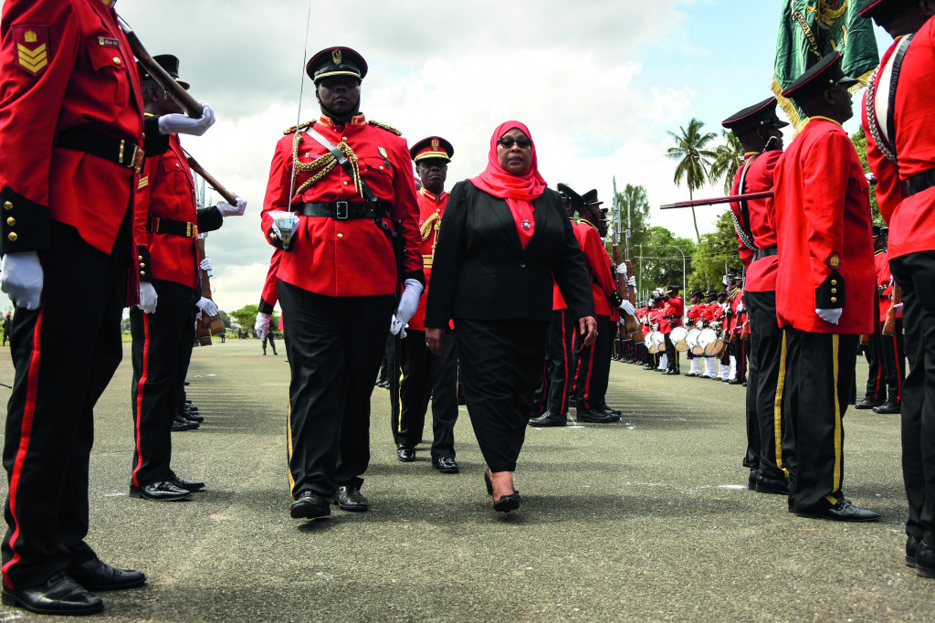 New Tanzanian President Samia Suluhu Hassan inspects a military honour guard after her swearing-in