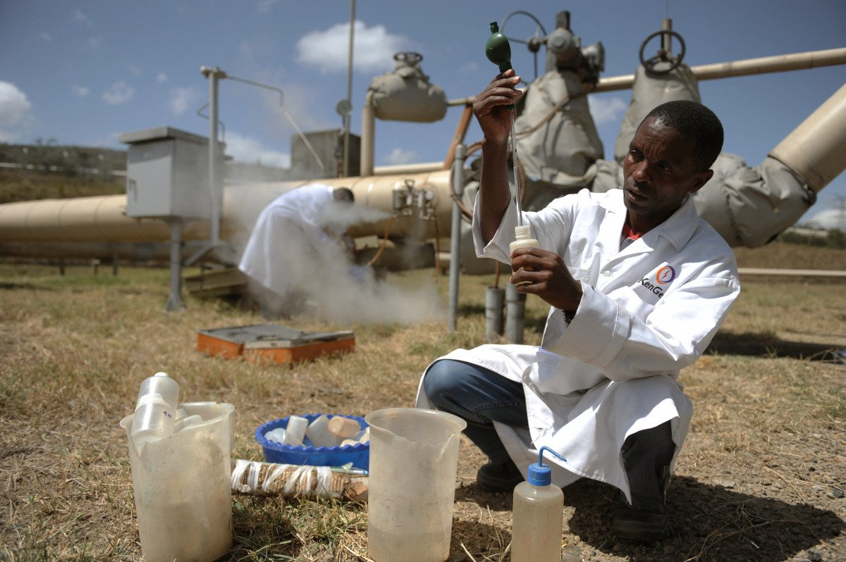 Kengen workers test a sample of condensed steam at a separator unit of a super heated steam well at the Olkaria geothermal site in central Kenya.