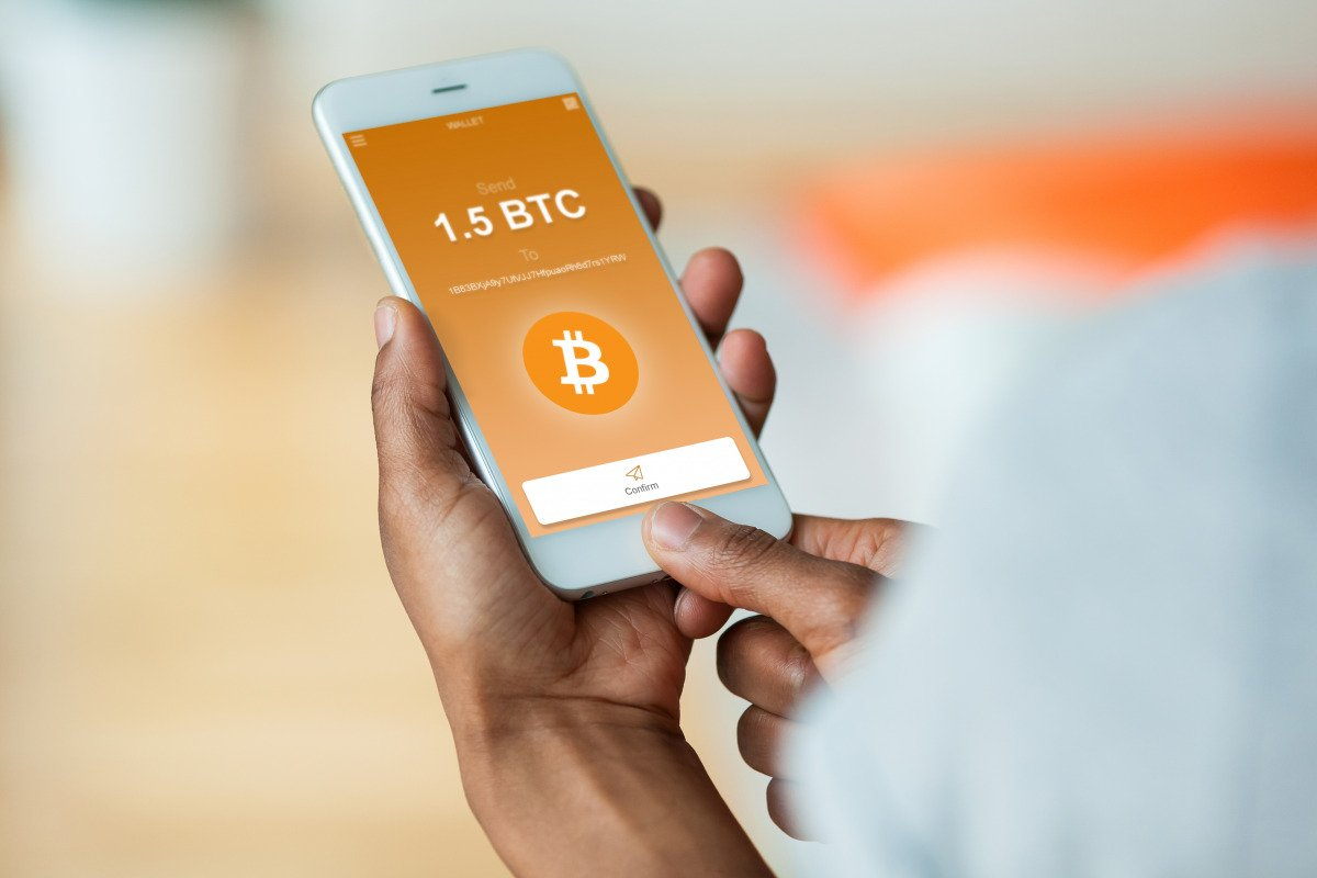 A mobile phone screen showing the Bitcoin logo.