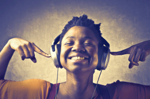 Smiling African woman listening to music.