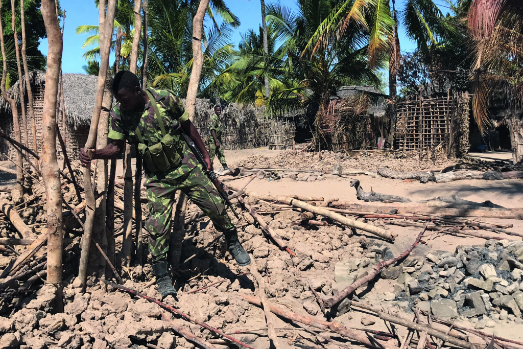 A Mozambican army soldier in a village burned down by insurgents in Cabo Delgado province.