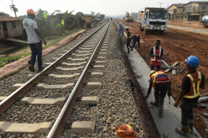 Workers lay a slab on Nigeria's new standard gauge railway.