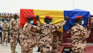 Chadian army officers bear the coffin of President Idriss Deby.