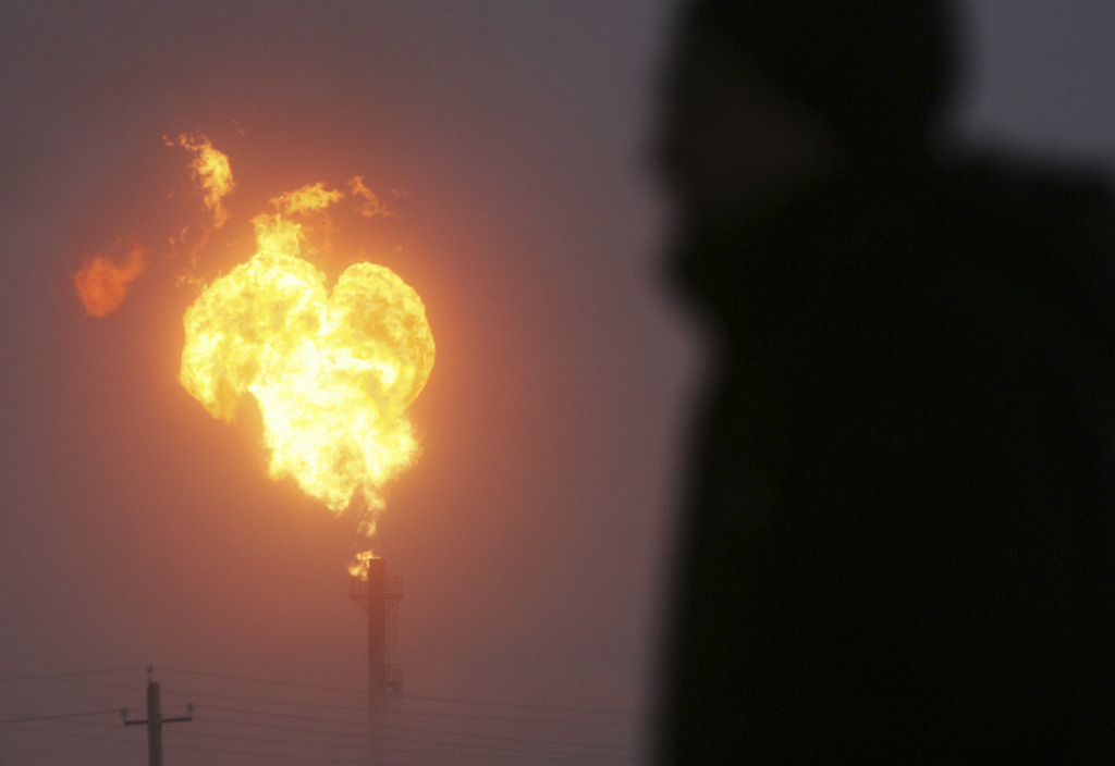 Natural gas flares from a rig.