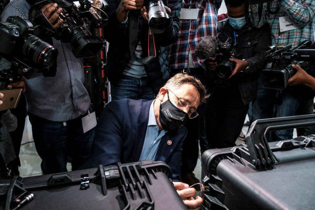 Photographers crowd round as a representative of the Global Partnership for Ethiopia Consortium opens a suitcase containing the group's bid at the Ethiopian telecoms auction in April.