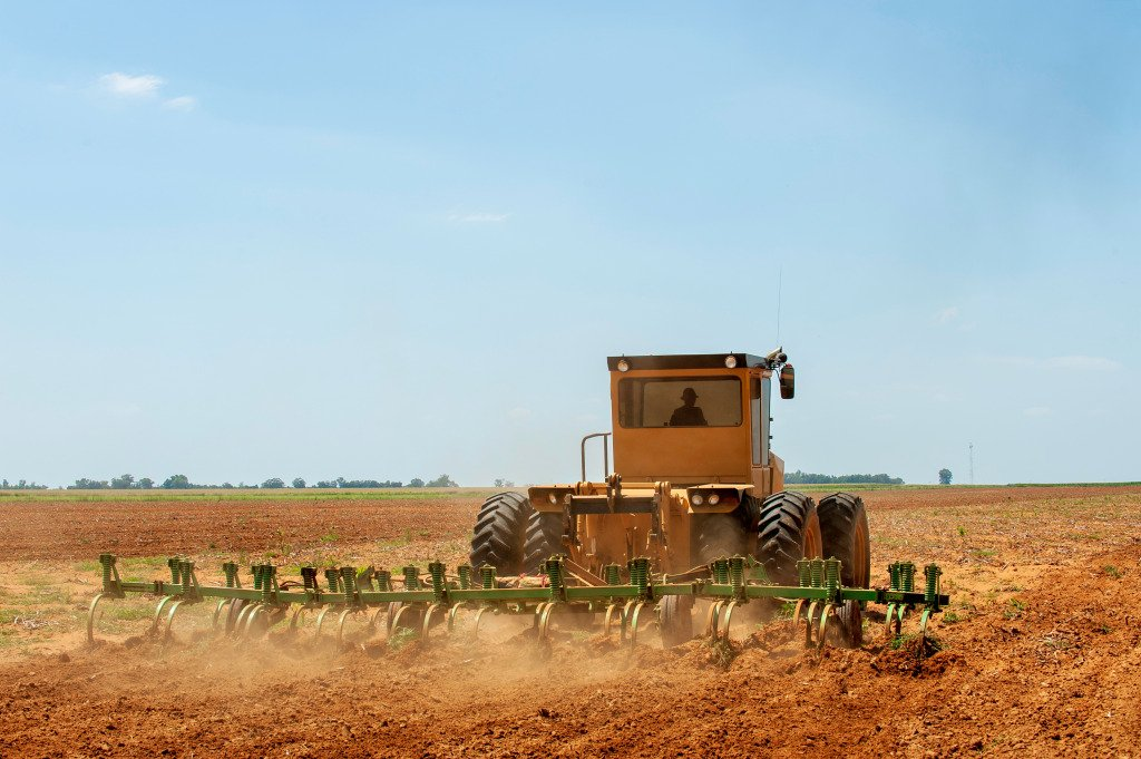 A tractor ploughs the fields in KwaZulu Natal in South Africa.