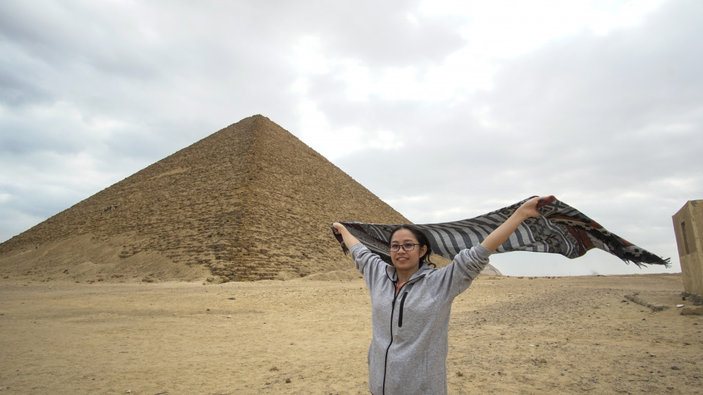 A Chinese tourist in front of the pyramids.