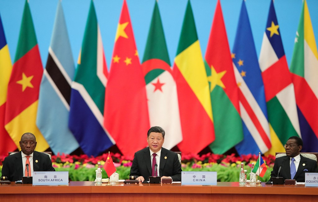 President Xi Jinping of China presides at the FOCAC conference in 2018, with Chinese and African flags behind him.