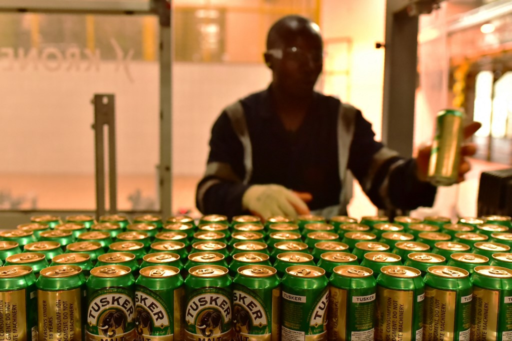 An employee of the East African Breweries Limited sorts canned beers.