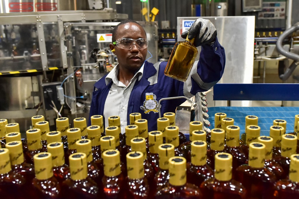 An employee of the East African Breweries Limited checks on quality of Kane spirit.