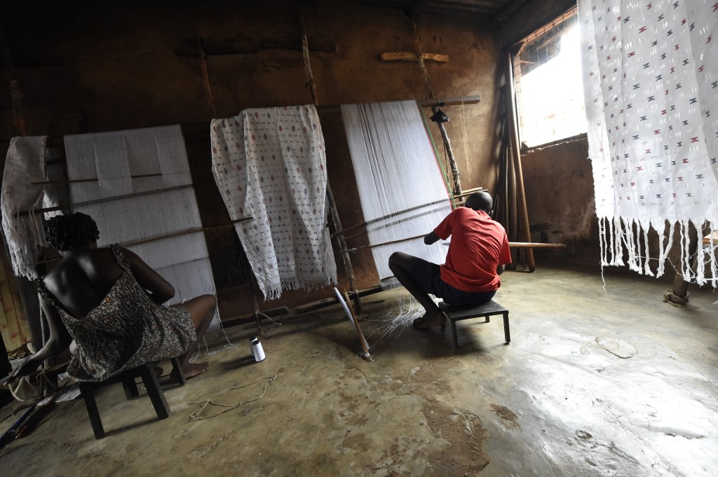 Weavers at work in Nigeria's Delta state.