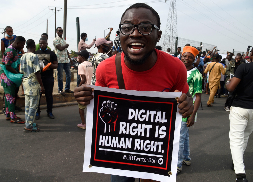 """A young Nigerian demonstrator carrying a placard saying """"Digital right is human right"""""""