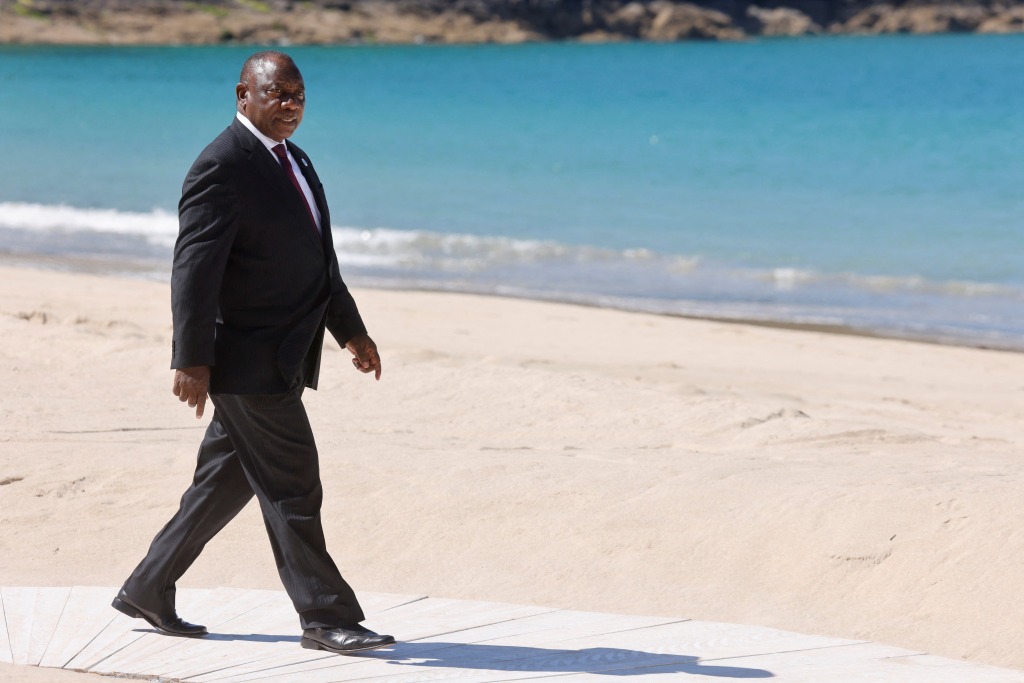 South Africa's President Cyril Ramaphosa walks on the beach as he arrives at the G7 summit in Carbis Bay, Cornwal