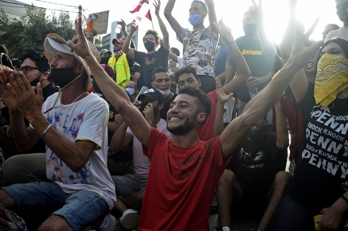 Supporters of the Tunisian president cheer in Tunis.