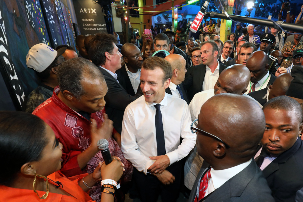 French President Emmanuel Macron surrounded by French and local people at the Afrika Shrine nightclub in Lagos.