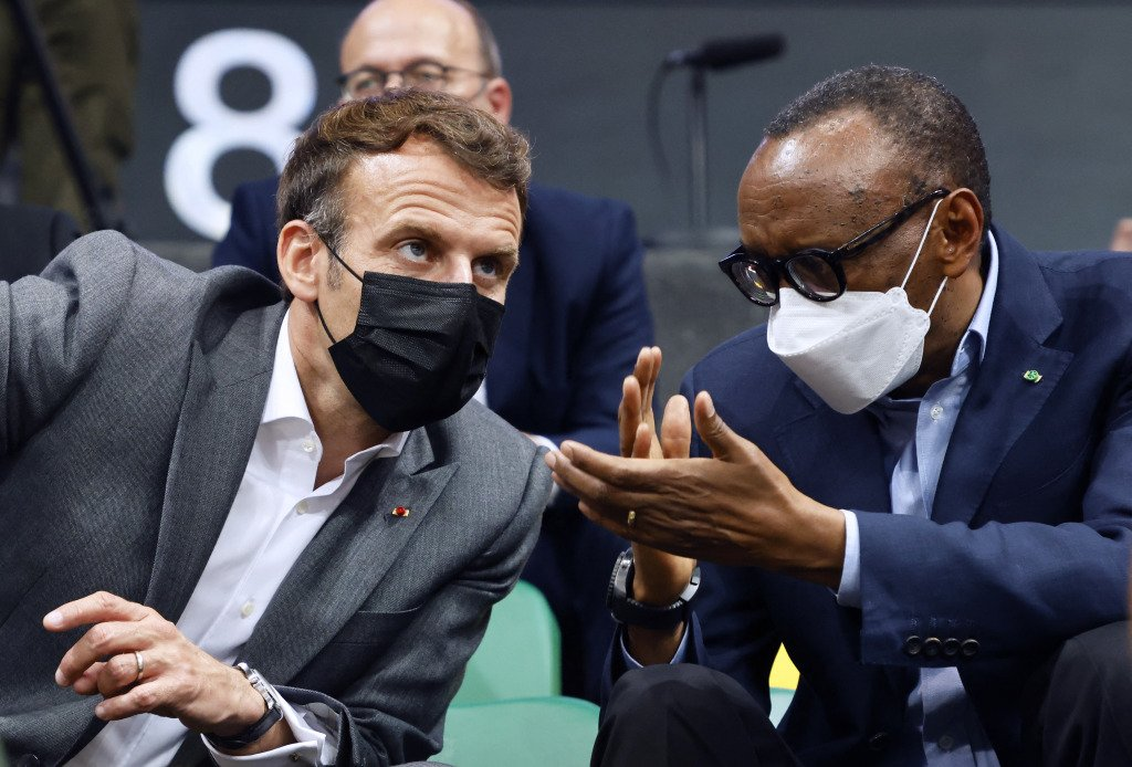 French President Emmanuel Macron and Rwanda's President Paul Kagame speak during a Basketball Africa League (BAL) match in the Kigali Arena.