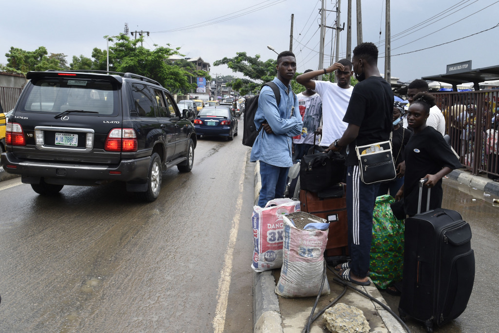 Nigerian students wait with luggage to leave the University of Lagos campus.