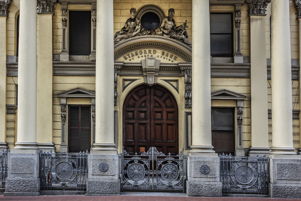 The headquarters of Standard Bank in Cape Town, showing a large door flanked by columns.