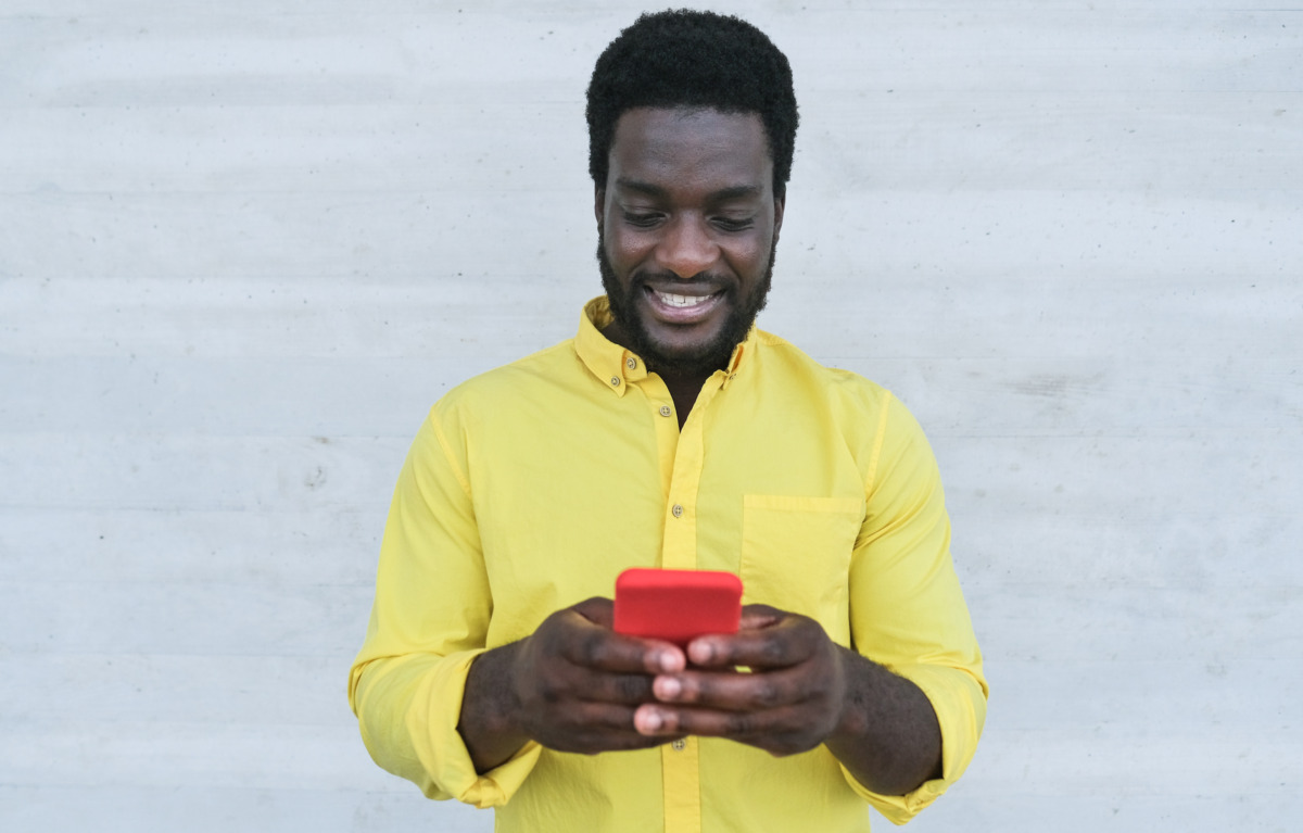African man looking at mobile phone